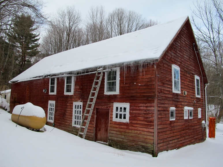 full barn, back view. winter.